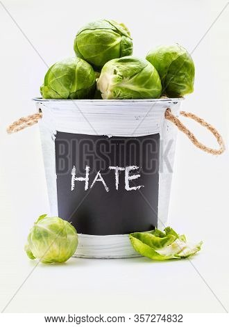 Raw, Fresh, Whole And Cut Brussels Sprouts (cabbages - Brassica Oleracea) In Bowl With The Word