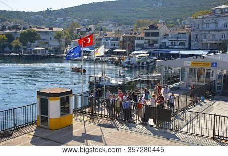 Burgazada, Turkey - September 18th 2019. Tourists Wait Behind The Closed Gates To Board The Ferry Fr