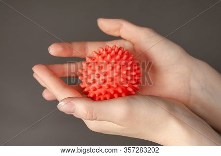 Conceptual Image Of A New Deadly Virus-coronavirus. Photo Of Hands On A Gray Background
