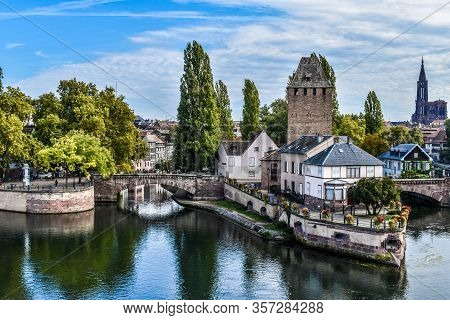 View On The Towers And Water Channels In The Historical City Center Of Strassbourg, France