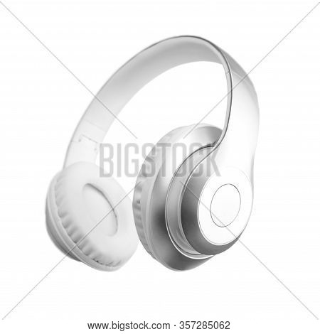 Silver Metallic White Wireless Headphones In The Air Isolated On White Background. Trendy Minimal Mu