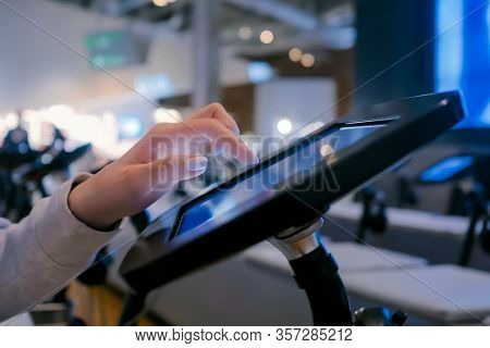 Futuristic, Education, Entertainment, Learning, Technology Concept. Woman Hand Using Touchscreen Dis