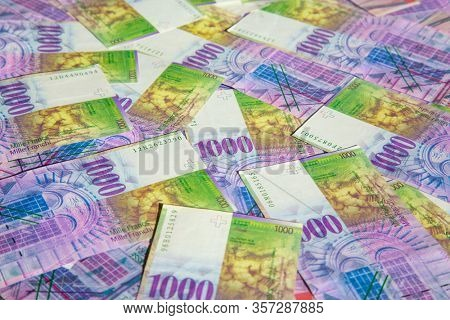 Collection of the Swiss 1000 franks banknotes. 1000 franks note issued by Swiss National Bank is one of the most valueable banknotes in the world.