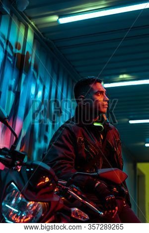 Selective Focus Of Mixed Race Cyberpunk Player Near Motorcycle