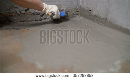 Waterproofing Coating. Cover The Concrete Wall With A Cement-polymer Waterproofing Membrane. Worker
