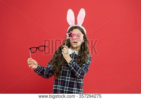 Having Fun. Schoolgirl Bunny Ears. Girl In Easter Bunny At Egg Hunt. Party And Social Event. Family