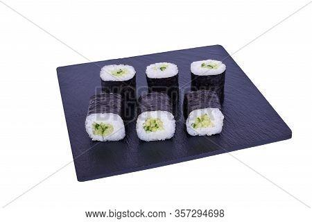 Traditional Fresh Japanese Sushi Maki On Black Stone Maki Capa On A White Background. Roll Ingredien