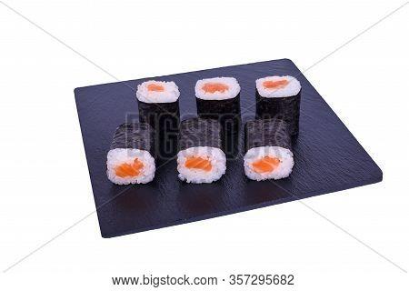 Traditional Fresh Japanese Sushi Maki On Black Stone Maki Syake On A White Background. Roll Ingredie