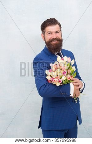 Waiting For His Girlfriend. Man In Jacket Holding Bouquet Of Flowers. Tulips For Womens Day. Happy B