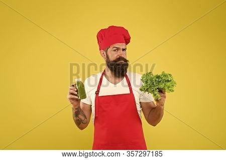 Same Food But Liquid. Fresh Juice. Squeezing Smoothie. Man Bearded Chef Hold Lettuce And Smoothie Bo