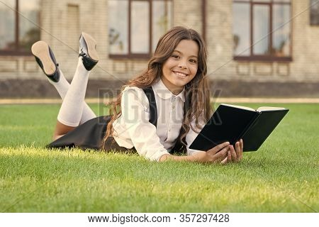 The Book Is Genius. Genius Bookworm Relax Reading On Green Grass. Happy Little Genius Read Book Outd