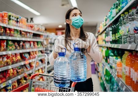 Woman With Hygienic Mask Shopping For Supplies.cpandemic Quarantine Preparation.hoosing Nonperishabl
