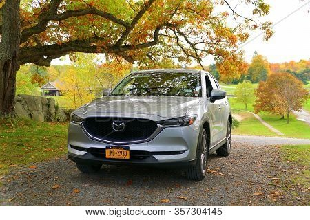 Wellesley Island, New York, U.s.a - October 25, 2019 - A Silver Mazda Cx-5 Suv Surrounded By Fall Fo