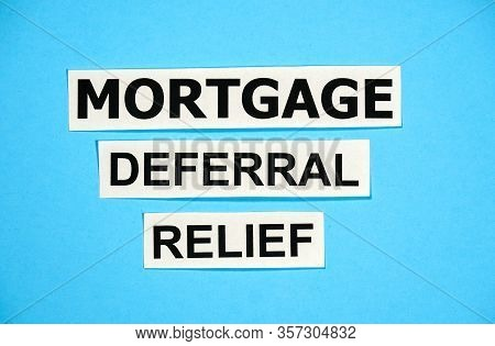 Mortgage Deferral Relief Writing On Blue Background. Many Banks Worldwide Announced Mortgage And Pay