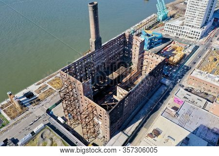 Brooklyn, New York - Feb 17, 2020: Former Domino Sugar Factory As Viewed From The Williamsburg Neigh