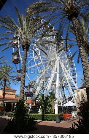 Irvine, California / USA- March 22, 2022. Ferris Wheel shut down to the public due to the Chinese Coronavirus19 Pandemic. Entire businesses and locations are shut by the government. Editorial Use