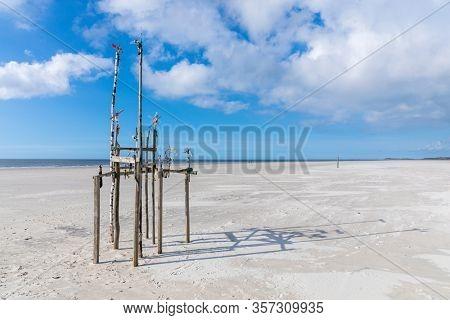 Object made of flotsam  like poles and sticks at the beach of Nebel on German North Sea island of Amrum