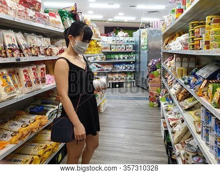 Gold Coast, Australia - March 21, 2020: Asian Female Wears Protective Medical Mask In Asian Grocery