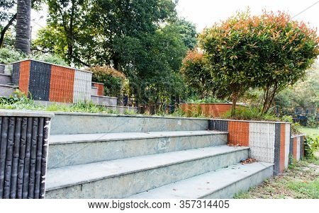 Marble Rock Made Steps And Staircases Park Bench Of A Public Park Decorated With Flower Plans. Front