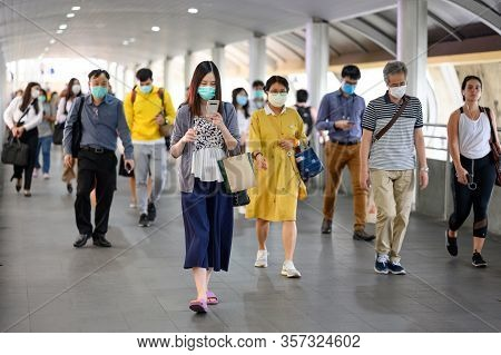Thailand, Bangkok - March 16, 2020 : Crowded People Wearing Face Mask For Protect Coronavirus (covid