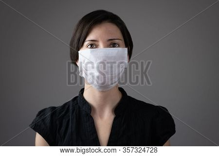 Brunette Woman Wearing Hygienic Mask To Prevent Infection, Airborne Respiratory Illness Such As Flu,