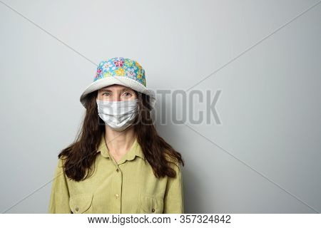 Positive Girl In Medical Mask And Panama
