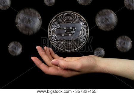 Elements Of The Dash Cryptocurrency Fall. Photo On A Black Background