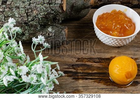 Apricot And Peach Jam In A Small Deep Dish, Sweet Orange Jam For Dessert. Next To A Whole Fruit, Apr