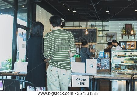 Social Distance Conceptual Small Business Waiter Serving Customer At Cafe..