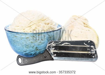 Sliced Cabbage In Bowl And Hatchet Knife White Background