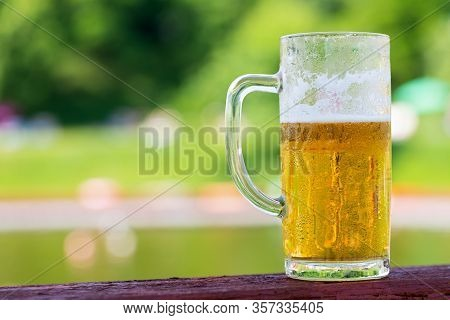 Close Up Picture Of Fresh Cold Draught Beer On A Restaurant Table