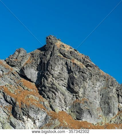 Satan Mountain Peak In Vysoke Tatry Mountains In Slovakia During Amazing Autumn Day With Clear Sky