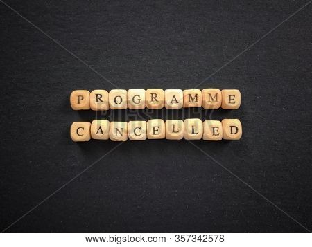 Programme Cancelled Written On Wooden Blocks. Blurred Vintage Styled Background.