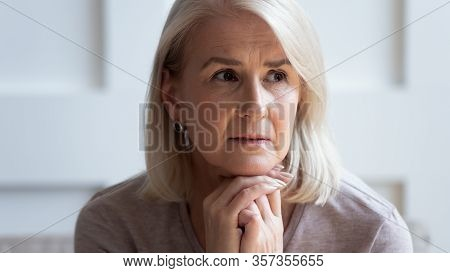 Head Shot Unhappy Upset Older Woman Thinking About Problems