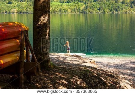 Bohinj, Slovenia - August, 01: Child On Paddle Board In The Bohinj Lake On August 01, 2019