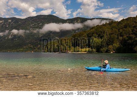 Bohinj, Slovenia - August, 03: Girl Kayaking In The Scenic Bohinj Lake On August 03, 2019