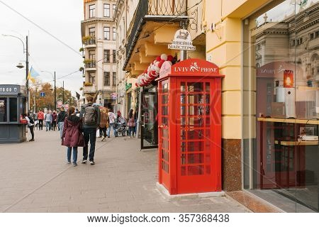 Lviv, Ukraine. March 2020. Red Telephone Box On The Streets Of Old Gord