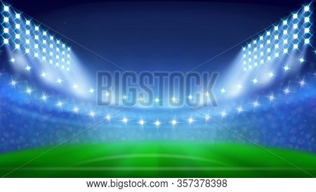 Soccer Stadium With Glowing Lamps In Night Vector. Blurred Stadium With Green Grass, Sitting Places