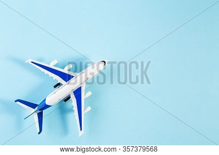 Model Plane, Airplane On Blue Pastel Color Background. Summer Travel Or Vacation Concept. Flat Lay O