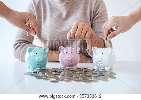 Image Of Hands Putting Coins Into Piggy Bank Planning Growing Saving To Strategy With Money Box For