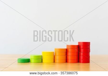 Wood Block Multicolor Arranging Stack Step As Staircase On Wooden Table. Business Concept For Growth