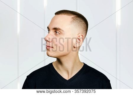 Portrait Of Young Man With Caesar Hair Cut, Side View.