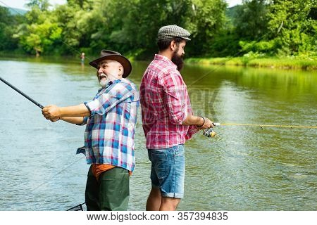 Father And Adult Son Fishing In Lake. Family Time. Man Bearded Fisher. Fishing Team. Big Game Fishin