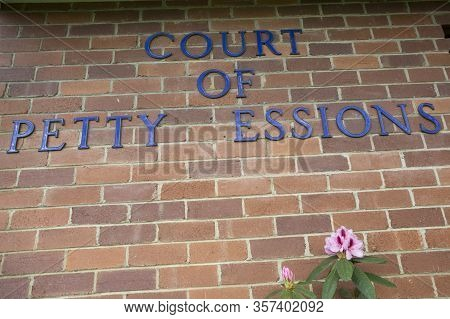 A Courthouse Sign With Stolen Letters, Irony Concept.