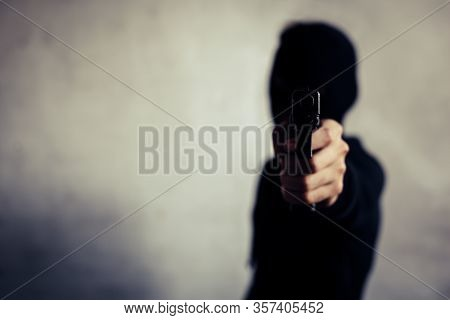 Man Aiming Gun And Ready To Shoot On Front View. People And Dangerous Weapons Concept. Criminal And