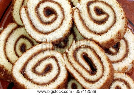 Swiss Sweet Roll With Jam On A Plate, Slices Of Homemade Sponge Roll Cake On A Plate.