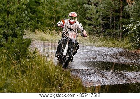 Motocross Enduro Race Athlete Motorcyclist Rides On A Forest Trail