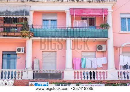 Tirana, Albania. February 2020: Colourful Building Facade In Tirana Albania. Clothes Hanged On The B
