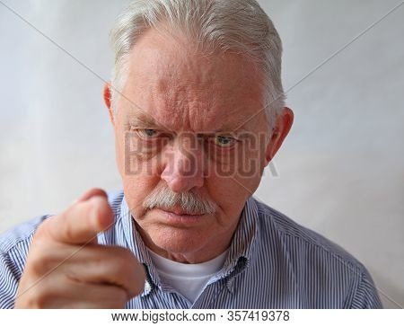 An Angry Senior Points An Accusing Finger, Focus On Face