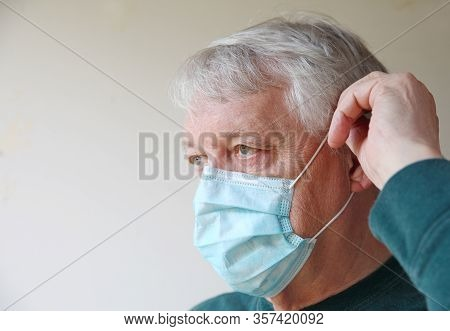 Older Man With A Medical Face Mask And Room For Text